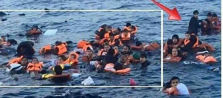 "Whoops. Standing man ruins ""drowning migrants"" photo-op."